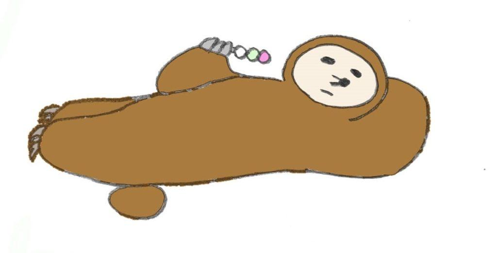 ブログ「モノオス」の管理人モノオスが寝転がって団子を食べている画像